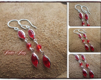 Swarovski drop earrings.