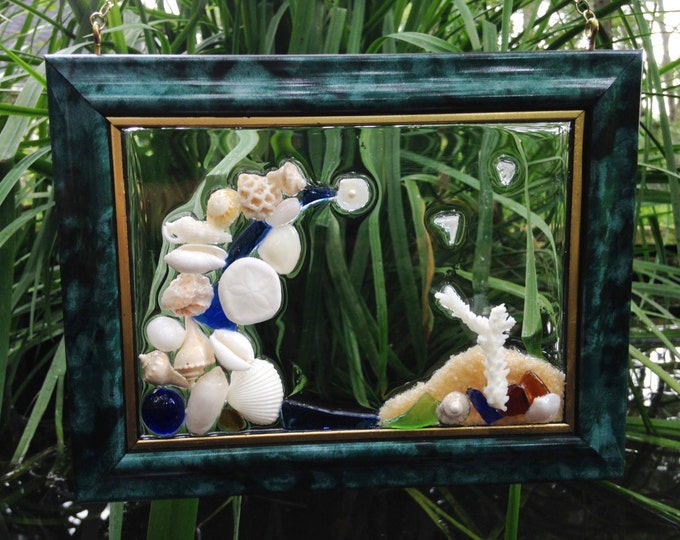 Seashell SunCatcher Window Hanger with Olives, Sand Dollar, Coral, Sea Glass, a Blue Bead Accent Exclusive Home Decor at Crafts by the Sea.