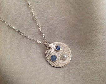 Handcrafted sterling silver round pendant with gemstones and freshwater  pearl