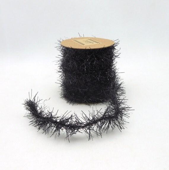 Black tinsel garland spool feet from