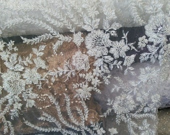 Glamorous bridal wedding beaded lace white. Sold by the yard