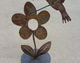 Metal hummingbird garden art
