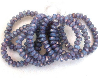 Dusty Blue semiopaque Crystal transparent UV active w/ Purple luster  3 x 5mm rondelles. Set of 30 or 60.