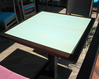 Brown and turquoise solid wood table top