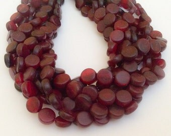 "Red horn beads 10mm coin 16"" strand"