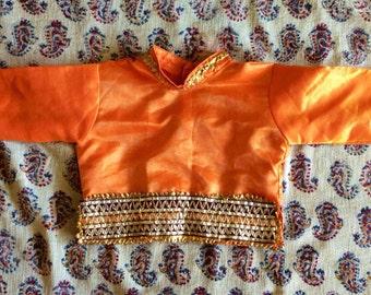 Bright orange silky embroidered shirt