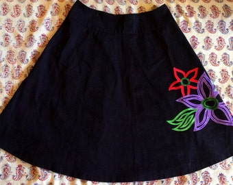 Black skirt with sewn on flowers