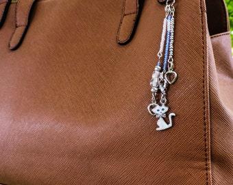 Blue eyed kitten purse charm