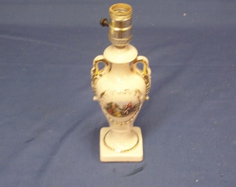 Vintage  small  white china  George and Martha  Bed side lamp , with 22k gold highlights and Swan handles