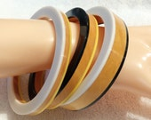 3 pc. Yellow, Black, and White Lucite and Wood Bangle Bracelets