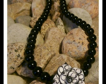 Black/white flower and black pearl beaded necklace and bracelet set.