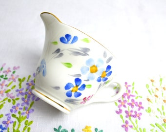 1930s hand painted china milk jug in pretty blues and pink by sutherland no. 2591
