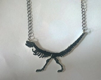 Black T-rex shrink plastic necklace.