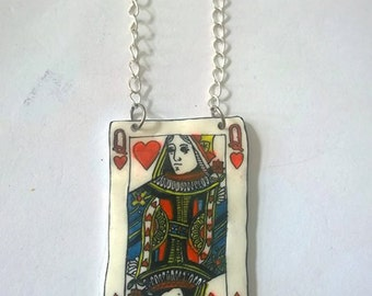 Hand drawn queen of hearts shrink plastic necklace.