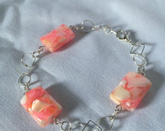 Pink and white glass beads and silver colored chain bracelet