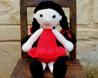 Handmade, crocheted toy doll for children and babies in red and black
