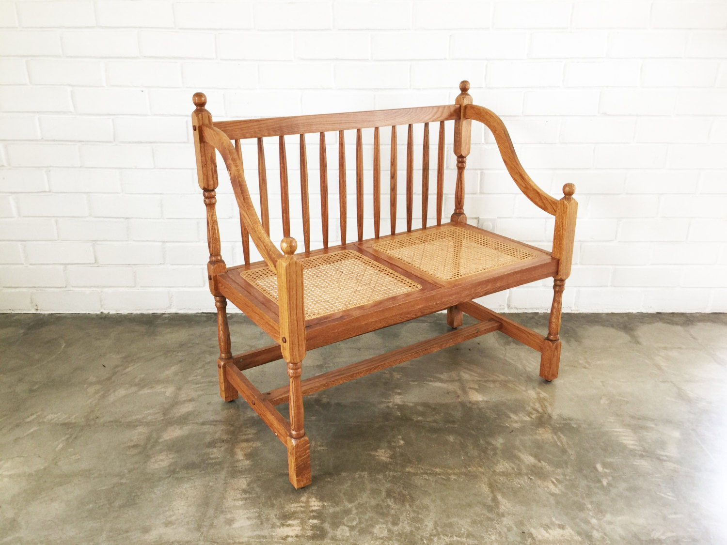 vintage wood and cane bench seat by 6thanddetroit on etsy