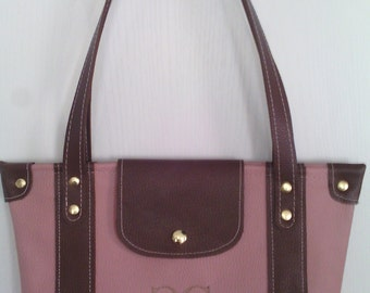bag has hand Original bi old color pink and Brown