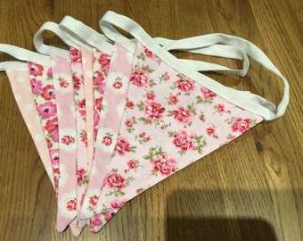 Bunting in vintage pink floral cottons. Eight flags on a two metre (6 feet) tape. Pretty pink flower fabrics for a vintage look