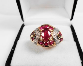 Ruby Ring.  Natural Rubies in a 14kt. Gold Ring with Diamond Accents