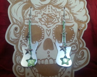 Silver guitar shaped earrings with stars
