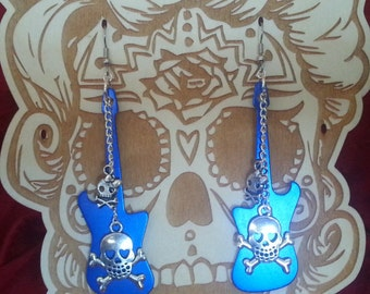Blue guitar shaped earrings with Skulls