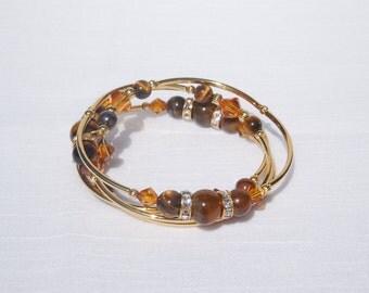 Tigereye, Swarovski topaz crystal and gold plated memory wire bracelet