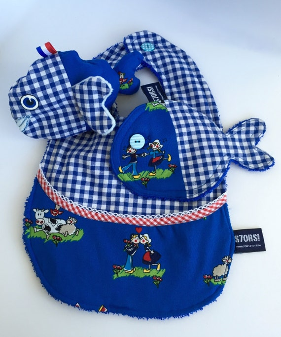 Holland themed 3-piece new born baby gift set. Including a bib, a wash cloth and a sensory stuffed toy fish with labels and super soft fins.