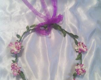 Beautiful purple flower headband with ribbon accent!
