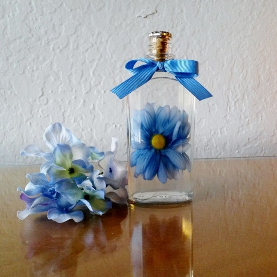 Blue silk daisy in recycled liquor bottle with by for Blue and silver bathroom ideas