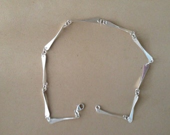 Sterling silver forged bar link necklace.