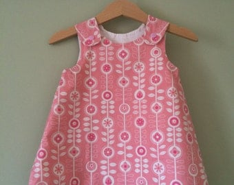 Baby girls' A line dress. Pink MODA Bump to Baby fabric. Modern twist on a floral pattern.