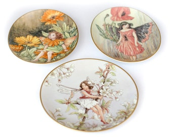 Fairy plates by Cecily Mary Barker 1980s Set of three sold together  Marigold  Cherry  Blossom and Poppy Fairy lovely wall decor