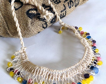 Necklace handmade using crochet with beige thread and different colorful beads