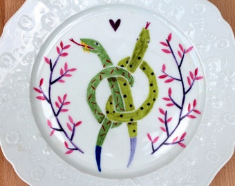 Snakes painted on ceramic plate - Twins