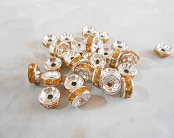 Rhinestone spacers. Amber Topaz crystal spacer beads. Silver plated rondelle spacer beads. 8 mm round spacers. Destash. Jewelry Supplies