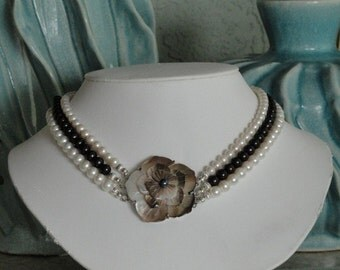 Pearl beaded necklace with Mother of Pearl flower pendant  -  71