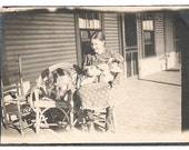 Reserved for D-Little girl with cat bunny dog zoo porch prairie rural photo image
