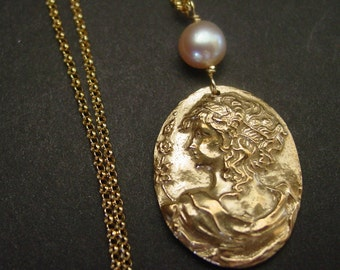 Small Aphrodite cameo with pearl necklace