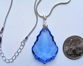Lovely Sky Blue ASFOUR faceted crystal Pendalogue PENDANT w/ a bright silverplated snake necklace chain