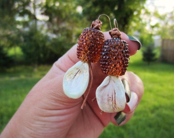 Iridescent and sparkling bronze dangle earrings. Lightweight. Flower petal drop, copper chocolate amber barrel beads. Every day fashion.