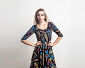 Plume Long Sleeve Twirling Dress in Magenta, Bright Blue, and Gold on Black