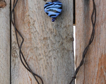 rusted baling wire heart with lavendar zebra striped heart and glass bead