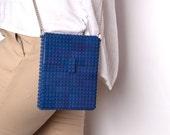 Dark blue hip clutch on a chain made entirely with LEGO® bricks
