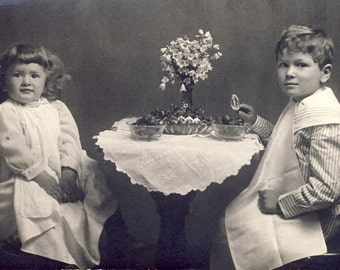 Children Sitting at Fancy LACE COVERED Table Enjoying Some FRUIT Photo Postcard Circa 1910