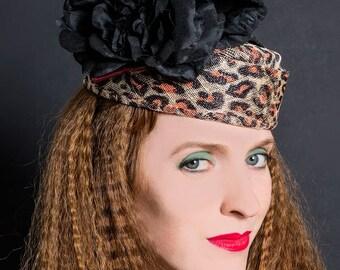Leopard print hat | pillbox with black flowers and swirled quills | formal hat | straw hat | animal print | Ascot hat | ladies wedding hat
