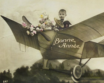 French Antique New Year Postcard - Boy in a Plane with Flowers