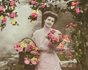 Antique French Postcard - Woman in a Long Pink Dress with Baskets of Flowers
