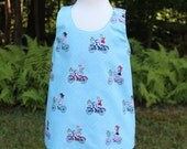 Reversible Pinafore Dress With Bicycle Riders and Vintage Market Fabric