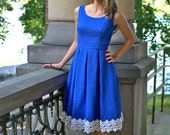 Dress with a pleated skirt in a bright blue linen with white lace trim, sizes US 0 to 16